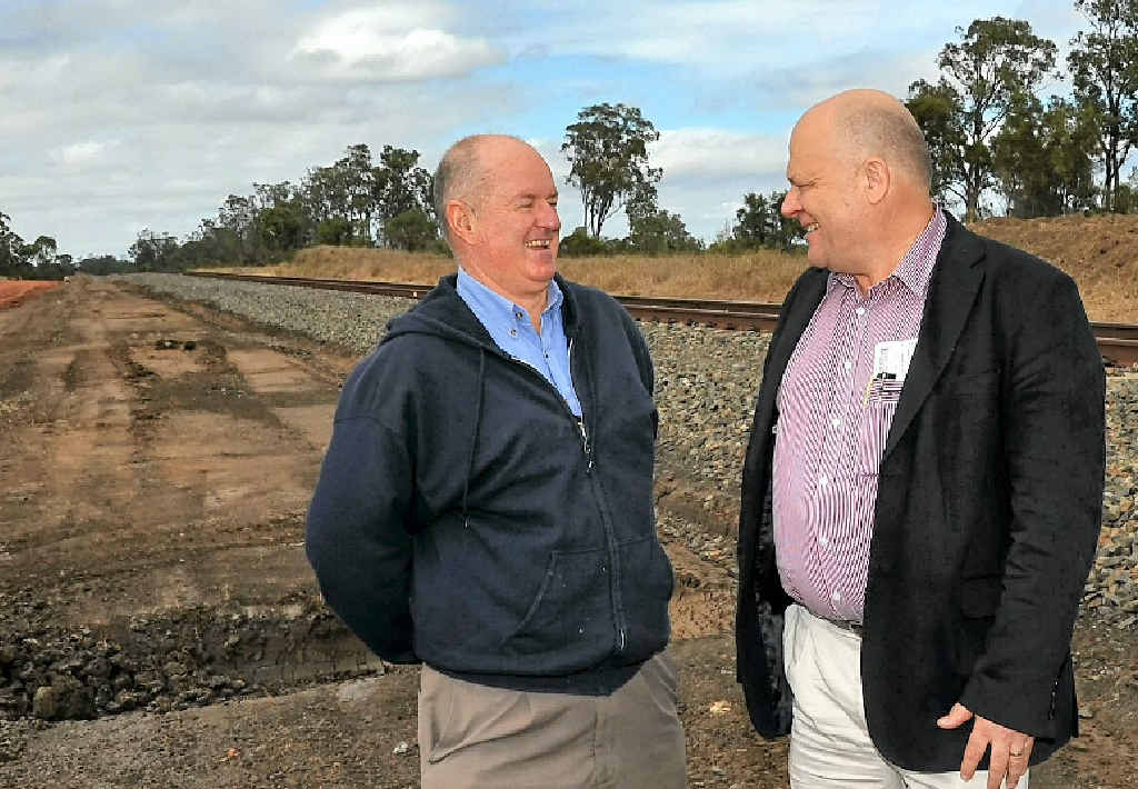 Banana Shire Mayor John Hooper and Origin project manager for pipelines Graeme Hogarth discuss the site of the new rail siding.