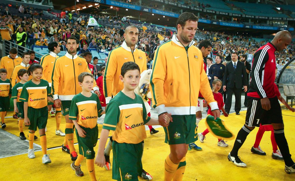 Lucas Neil leads out the Socceroos.