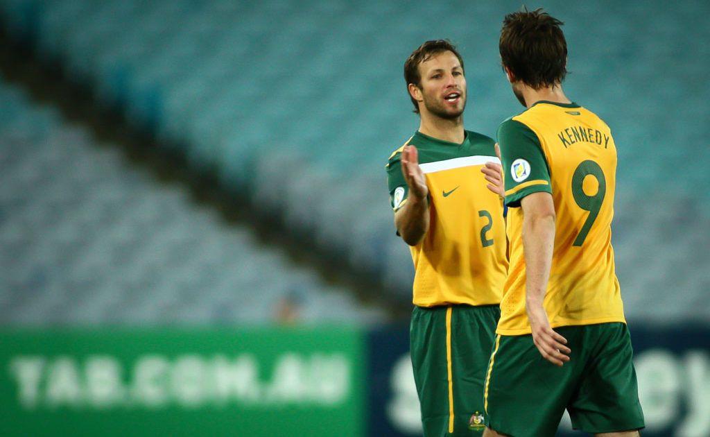 Socceroos captain Lucas Neill with team-mate Josh Kennedy.