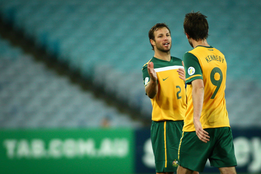 Socceroos captain Lucas Neill with team-mate Josh Kennedy.