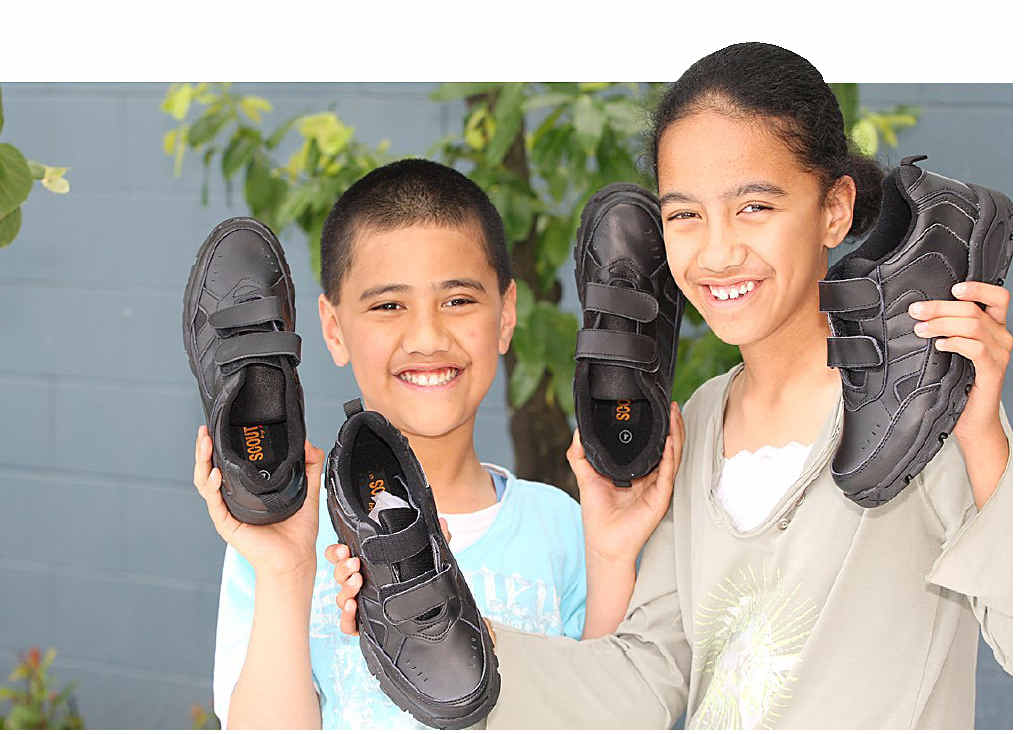 INSPIRATION: Spencer Martin, 9, and Justine Matthews, 10, with some of the shoes to be given away.INSET: A thank you note from a grateful recipient.