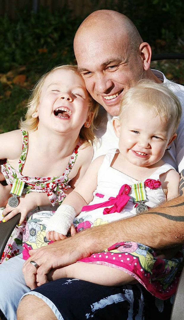 """Sisters Eva, 5, and Elinor Whitehead, 1, were given medals for """"perseverance"""" while dad Danny was overseas."""