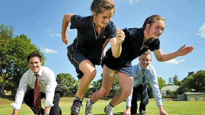 Liam Brown (left) and Matt Evans get in some training for tomorrow's Celebrity Charity Relay with Fairholme students Dominique du Toit (left) and Eliza Perkins who will contest the Junior Gift on the Fairholme College main oval.