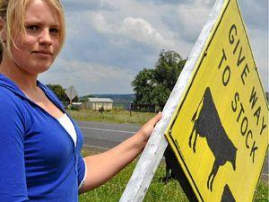 Farmer cops dept order over signs