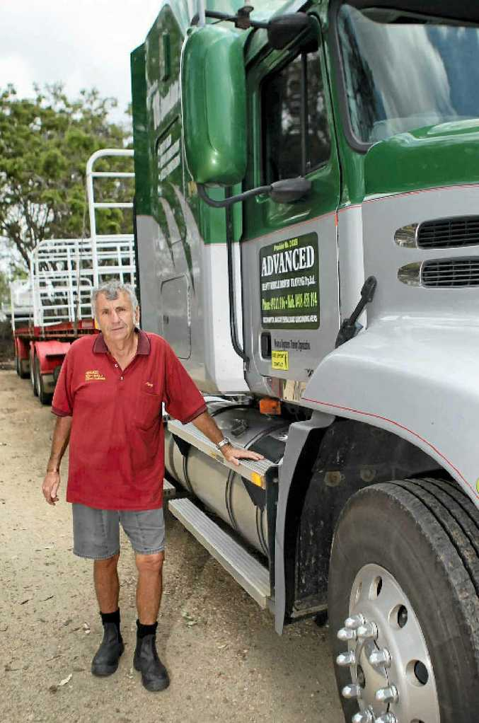 Max Manley stands alongside one of the heavy vehicles he uses for driver training.