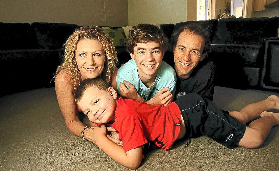 Zane Watkins, 6, with his family David and Joanna and brother Jye.