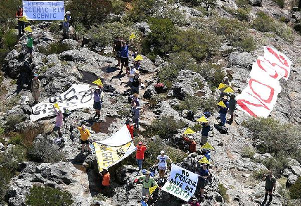 Protesters made their opposition to coal and coal seam gas mining pretty clear during a mountain-top campaign yesterday.