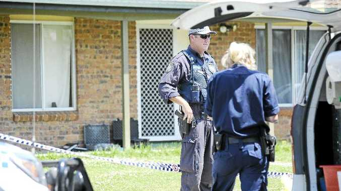 Police and forensic teams at the house in Ballina on Johnson Dr where a woman died and a man was charged with murder.