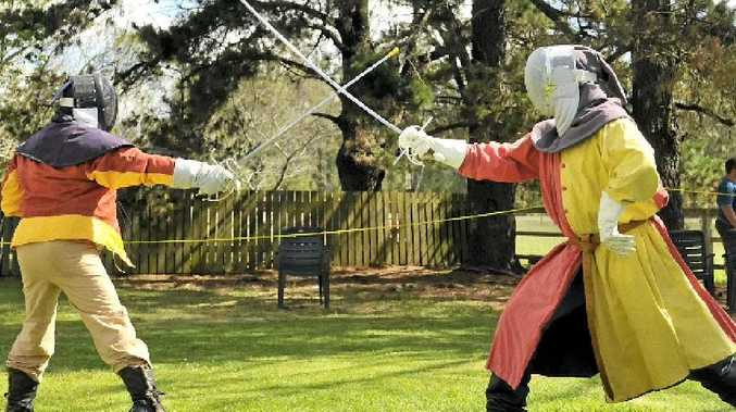 Ralph Picton and Brad Giles fence with rapiers at the medieval/renaissance open at Cabarlah Hall yesterday.