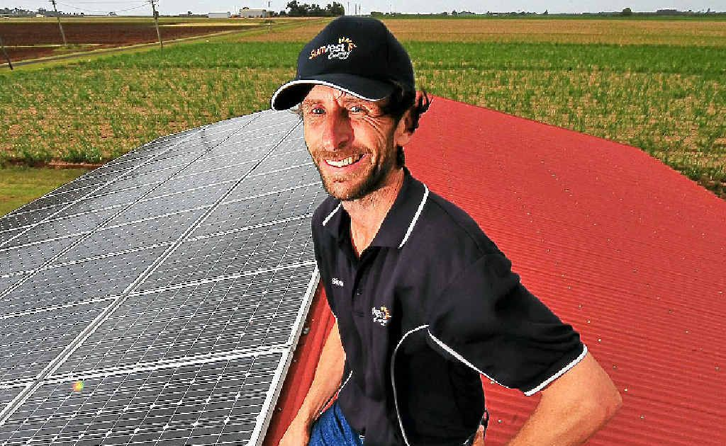 Simon De Bomford with one of the solar electricity systems he has installed around the region.