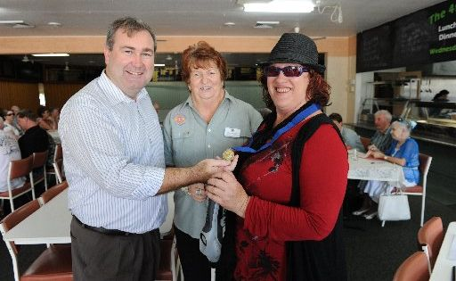 ON TRACK: Member for Bundaberg Jack Dempsey presented Ros Matthews with a medallion marking her graduation from UltraCane training. Also present is president of the North Bundaberg Lions, Coral Mayfield.