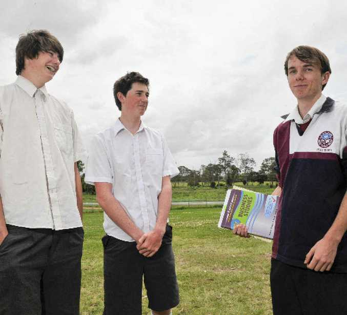 Jack Ball, 17, Ben Adams, 17 and James Bowles, 18, of McAuley Catholic College have a chat after finishing their first HSC exam, Business Studies.