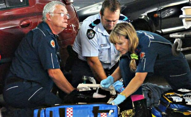 Paramedics and police try to save the life of Jackson