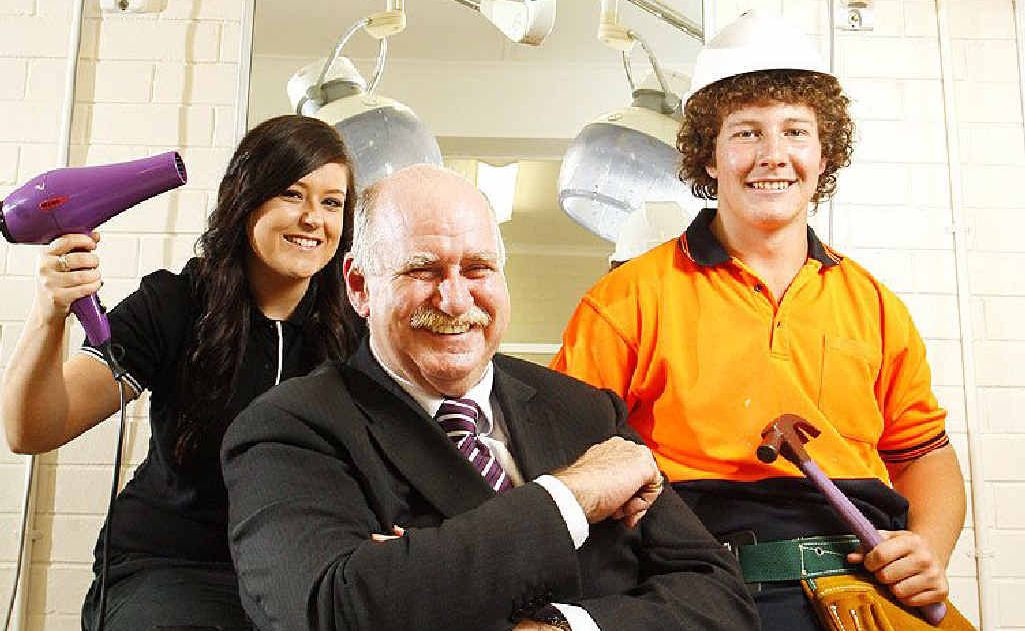 Ipswich State High School students Chloe McCoombes and Josh Braaksma, with Springfield Land Corporation's Terry Kearney, celebrate being job-ready.
