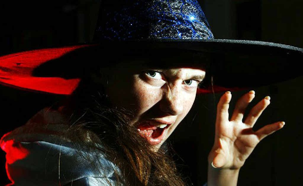 Emily Booth, 12, prepares to scare for Halloween. Ipswich business have teamed up to promote a safe trick or treat for children this year followed by a glow stick party.