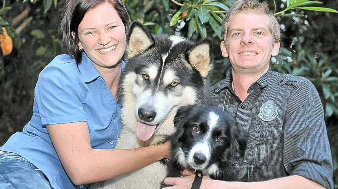 Melissa Bruce and Andrew Murphy are happy together as mutual dog lovers with Storm and Savannah.