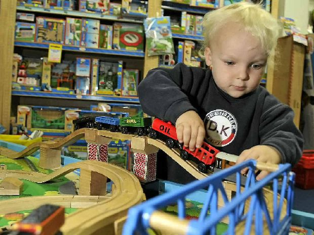 Angus Dowe, 2, loves playing with the Thomas the Tank Engine toys, which still prove to amuse children.