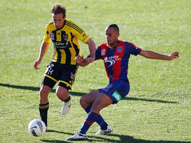 Nick Ward (left) playing for the Wellington Phoenix.