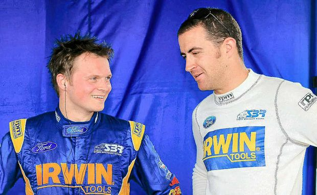 German driver Marc Lieb talks to his Gold Coast 600 co-driver Alex Davidson during practice yesterday at the Queensland Raceway.