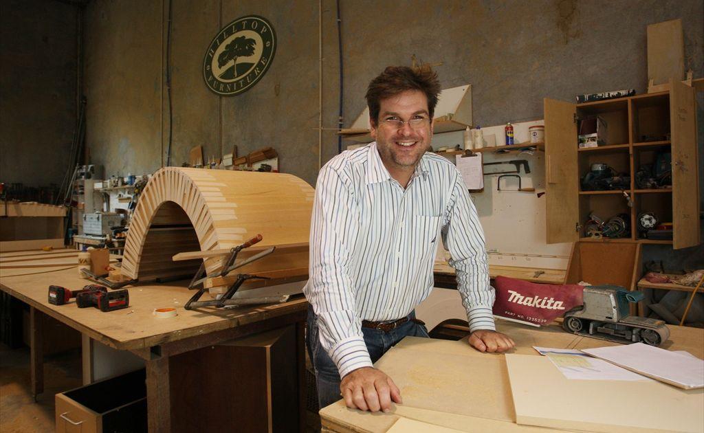 Owner of grain furniture Richard Sachs inside his Warana workshop.