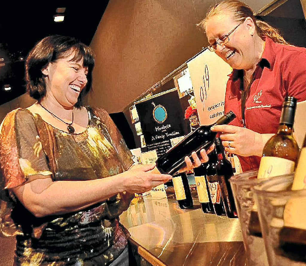 WHAT A CORKER: Happiness comes in bottles at Adelaide's Cellar Door Wine Festival.