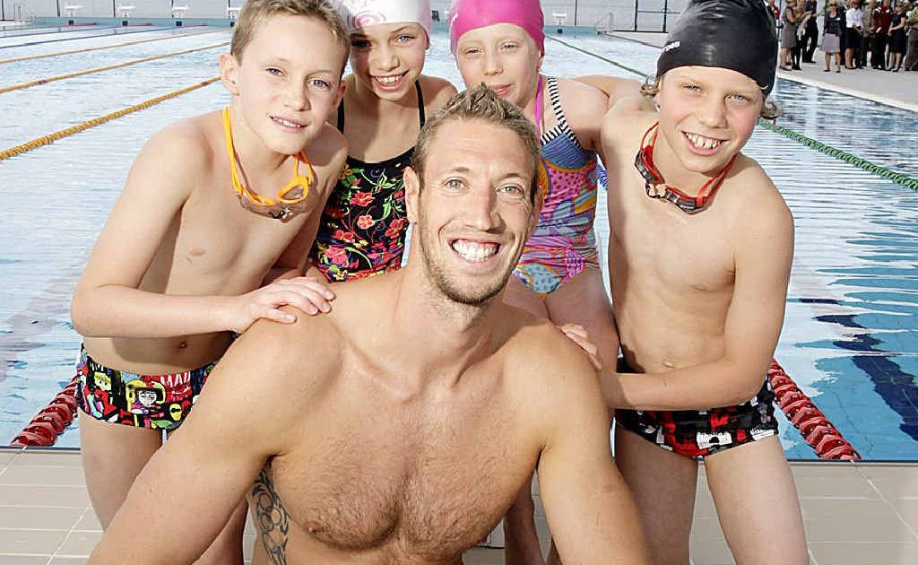 French swimming star Alain Bernard with some young fans at the official opening of the University of the Sunshine Coast's new pool.