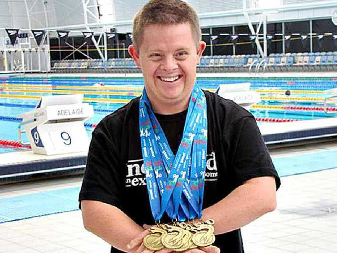 Clinton Stanley shows off his six gold medals from the Masters Games in Adelaide.