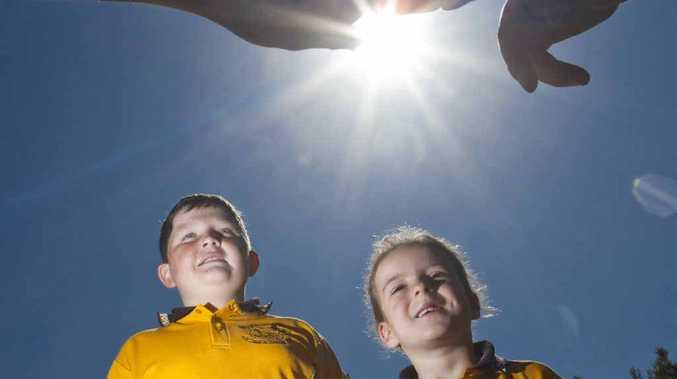 Liam Gillett, 11 and Molly Dobbin, 7 get ready for Gulmarrad Public School's showing of ET under the stars.