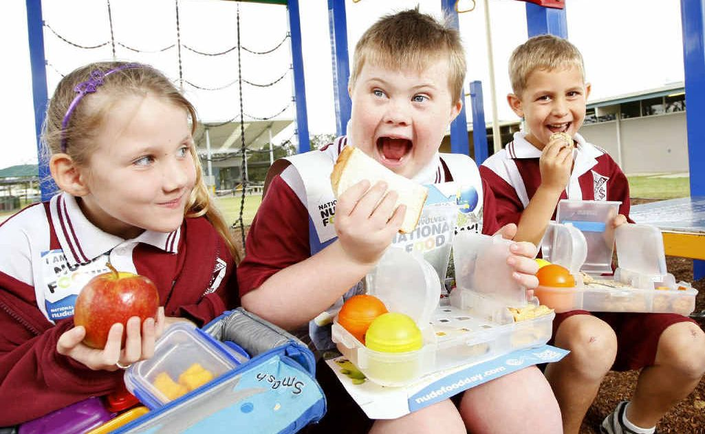 Bundamba State School students from left, Paige Worwood, Ben Westwood, and Harris McDermid eat food from special lunch boxes that limit the need for unnecessary packaging.