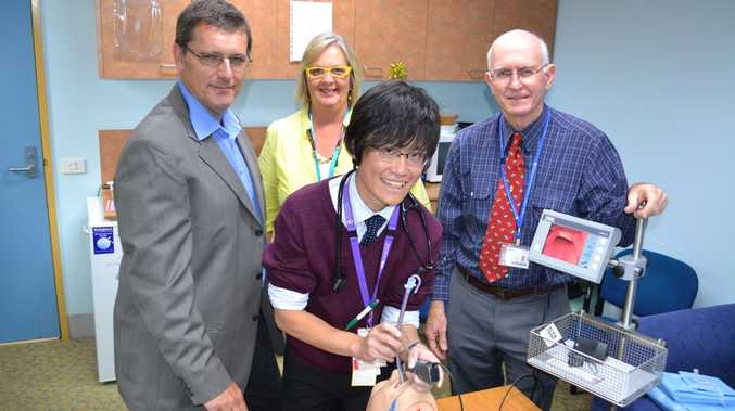 IN TRAINING: Final-year medical student Bruce Chau (front) perfects his intubation technique with (back, from left) director of anaesthetics Dr Mal Malan, anaesthetic technician Gail McDonald and Rural Clinical School clinical director Dr George Tucker.