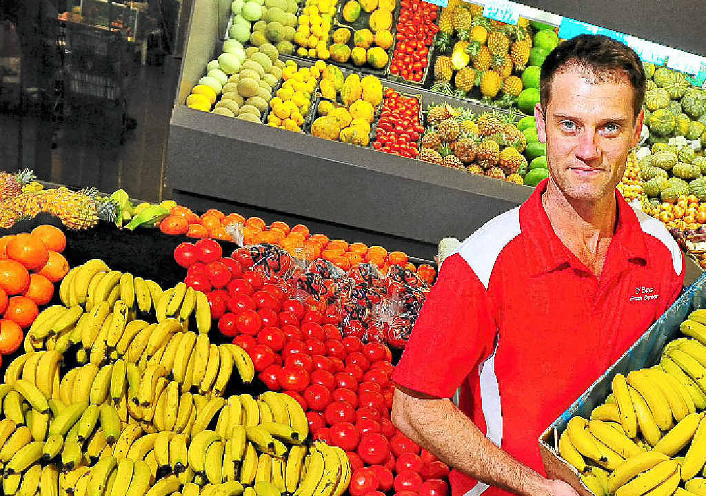 Oboy's Fresh Express owner Darryl Schulte with a box of local bananas that are now down to $5.99kg.