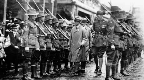 The Prince of Wales, who late became King Edward VIII, inspects an honour guard at Ipswich station in 1920.