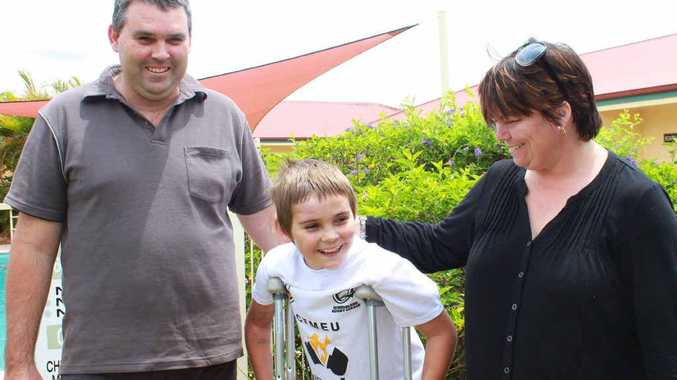 Cory and Liz Bond with Lachlan who is on the mend after being hit by a utility on the Gregory Hwy.
