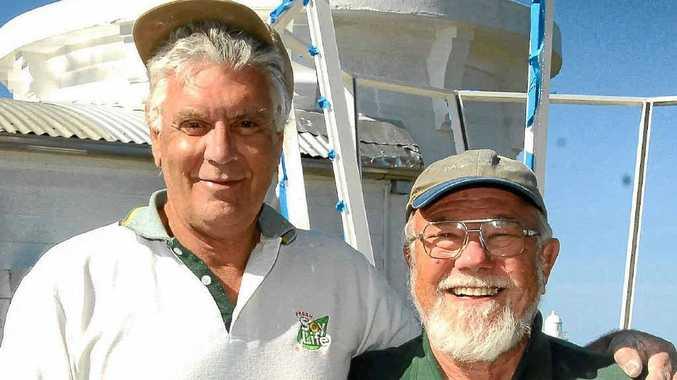 Volunteer mates up at Yamba's replica lighthouse are Roland Smith, of Brisbane, and John Ibbotson, of Gulmurrad.