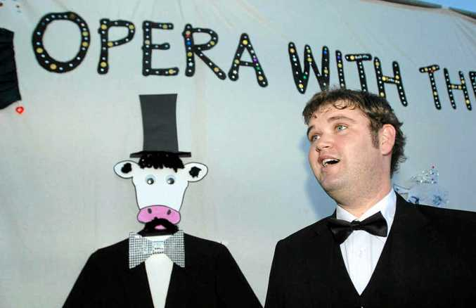 Troy Castle gets into the groove for his performance at Cowper Public School's Opera with the Cows on Saturday night.