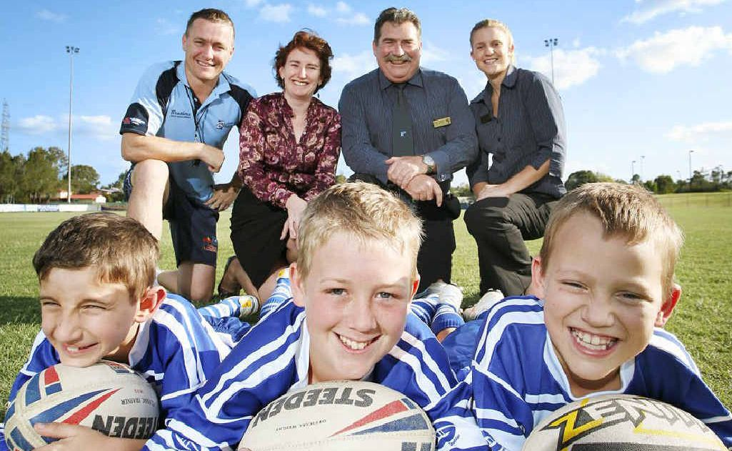 Brothers junior players from left, Will Stoddart, 8, Jack McAteer, 11, and Dylan McAteer, 8, and rear from left, junior coaching and development officer Jason Connors, Rachel Nolan MP, Brothers Leagues Club general manager Mark Hennelly, and sport and recreation coordinator Sarah Cassin.