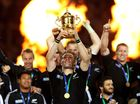 All Black captain Richie McCaw holds aloft the 2011 Rugby World Cup trophy after New Zealand beat France at Eden Park.