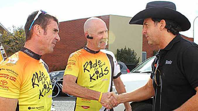 Pittsworth cyclists Mark Droney (left) and Phil Leydon meet Lee Kernaghan before embarking on a ride from Pittsworth to Dalby.