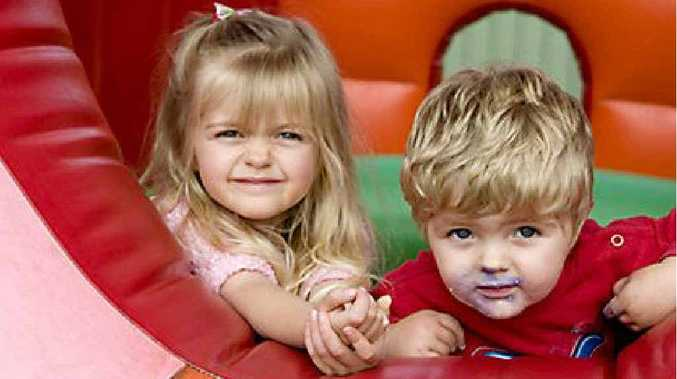 Seeking refuge on the outer regions of the jumping castle are Leona, 3, and William Downling, 18 months.