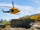 The Careflight helicopter hovers near the Yamba Lighthouse headland while rescuing a boy who washed off rocks.