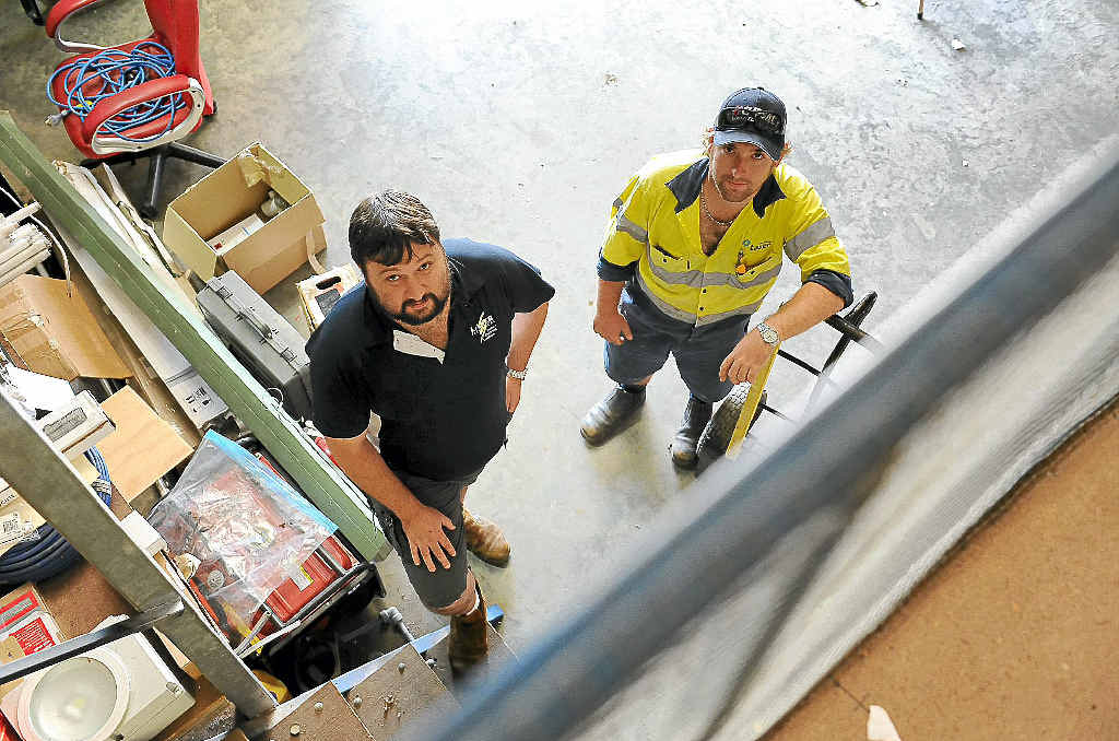 Laser Electrical managing director Matthew Kummerow, with tradesman Tim Fooks, is sick of training up apprentices who leave soon after for big mining pay packets.