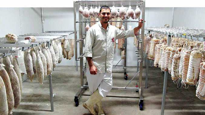 FINDING A CURE: Massimo Scalas, from Salumi Australia, uses Australian pork.