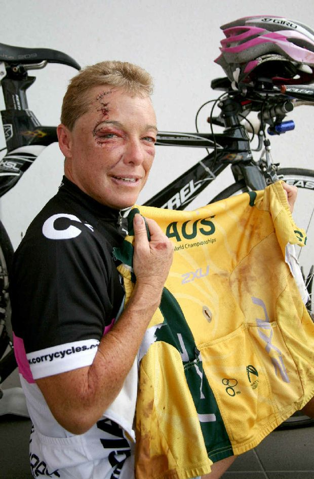 Champion triathlete Lisa Harding holds her torn 2009 World Longcourse Championships Australian shirt, which she was wearing when she came off her bike on the Bruce Hwy, south of Bakers Creek. Ms Harding received facial injuries and bruising.
