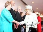 Queen Elizabeth greets flood victims Lynette (left) and John Lynch of Fernvale during her visit to Brisbane yesterday.