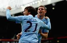 David Silva (left) and James Milner celebrate as Manchester City march towards their first EPL title.