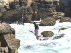 Dangerous way to get your kicks; a youth in freefall off the cliffs at Pilot Hill, Yamba.