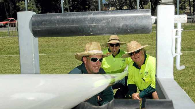 Lismore City Council sports field fabrication supervisor Daniel Kubelka (left), sports field team member Brendon Lane and team leader Warren Baxter with their invention – an apparatus that makes the installation and removal of goalposts safer.