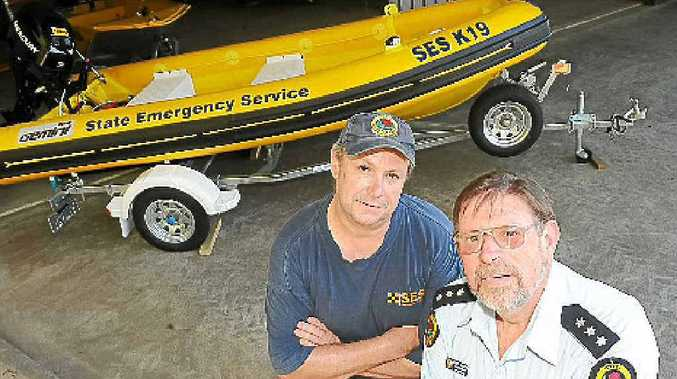 SES deputy controller Ian Leckie and unit controller and acting local controller Stuart Ferguson with the new flood rescue boat.
