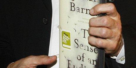 Julian Barnes with his novel The Sense of an Ending.