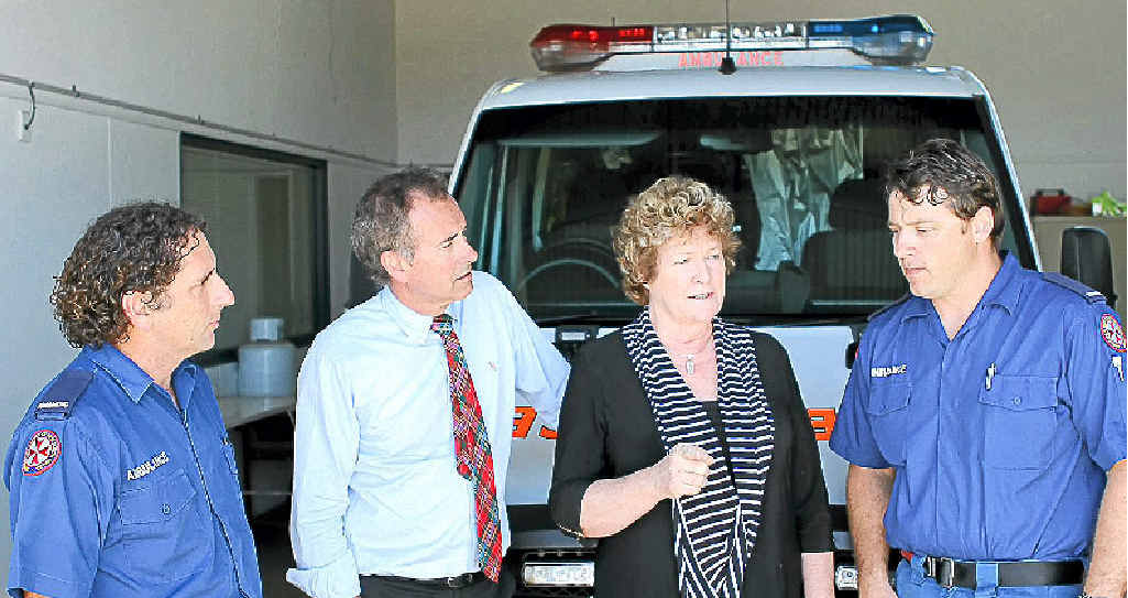 Paramedics David Jeffrey and Gavin Bridges talk to NSW Health Minister Jillian Skinner and Nationals Candidate for the Clarence by-election Chris Gulaptis at the Yamba Ambulance Station about issues facing the NSW Ambulance service.
